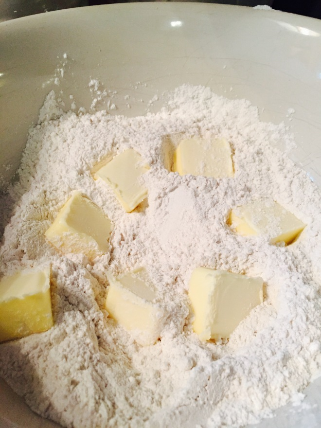 Add the cubes of butter to the flour, baking powder, salt and sugar.